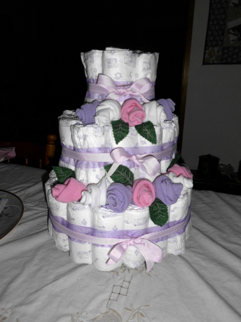 nappy[diaper] cake with baby sock roses and embroidered felt leaves
